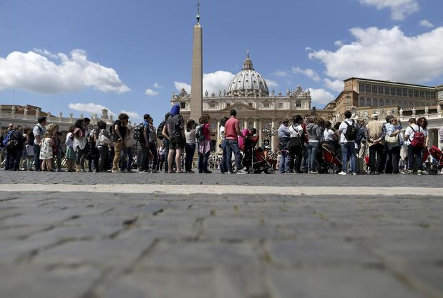 People line up to visit St. Peter's Basilica at the Vatican April 24, 2014. REUTERS/Alessandro Bianchi