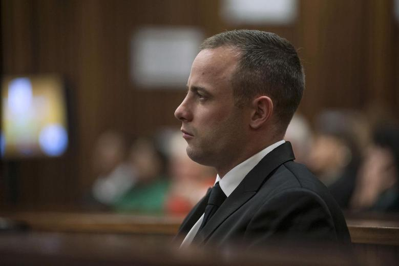 Olympic and Paralympic track star Oscar Pistorius sits in the dock in the North Gauteng High Court in Pretoria May 5, 2014. REUTERS/Ihsaan Haffejee/Pool