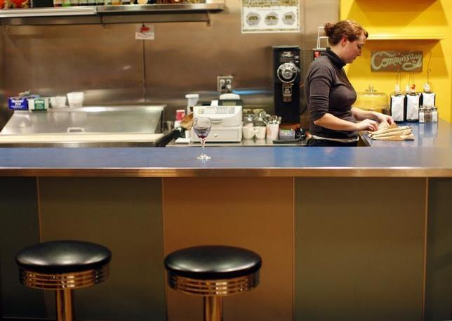 A waitress stands behind the counter at AS220 Restaurant in Providence, Rhode Island November 17, 2009 FILE PHOTO. REUTERS/Brian Snyder