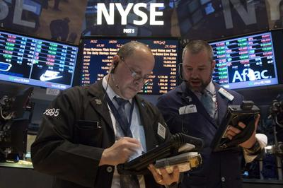 Wall St. ends up as ISM data upbeat; Apple above $600