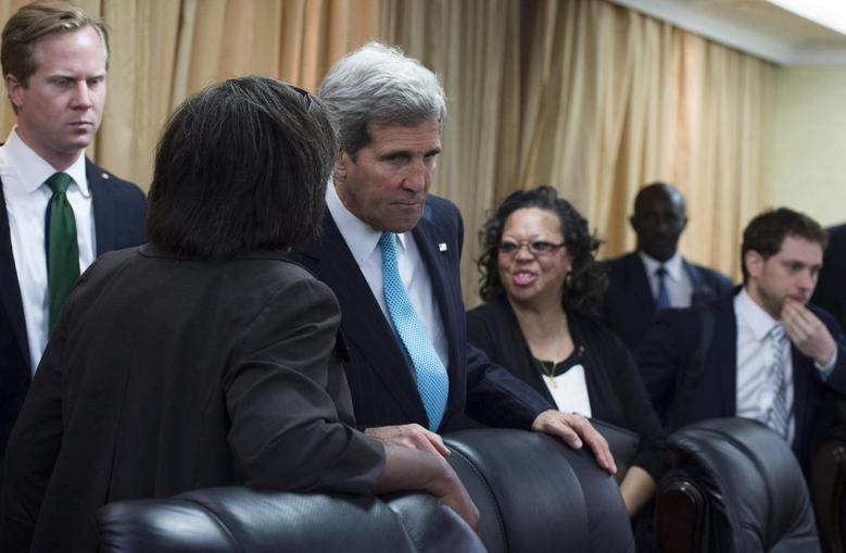 U.S. Secretary of State John Kerry (3rd L) speaks with aides prior to a meeting with South Sudan's President Salva Kiir at the President's Office in Juba May 2, 2014. REUTERS/Saul Loeb/Pool