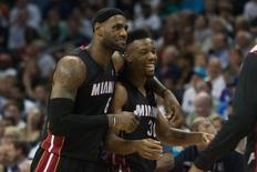 Apr 28, 2014; Charlotte, NC, USA; Miami Heat forward LeBron James (6) celebrates with guard Norris Cole (30) after hitting a shot at the end of the third quarter against the Charlotte Bobcats in game four of the first round of the 2014 NBA Playoffs at Time Warner Cable Arena. The Heat defeated the Bobcats 109-98. Mandatory Credit: Jeremy Brevard-USA TODAY Sports