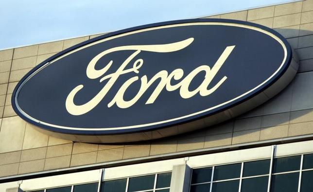 The Ford Motor Co's logo is seen on top of the Ford Motor Company World Headquarters in Dearborn, Michigan, October 26, 2009. REUTERS/Rebecca Cook