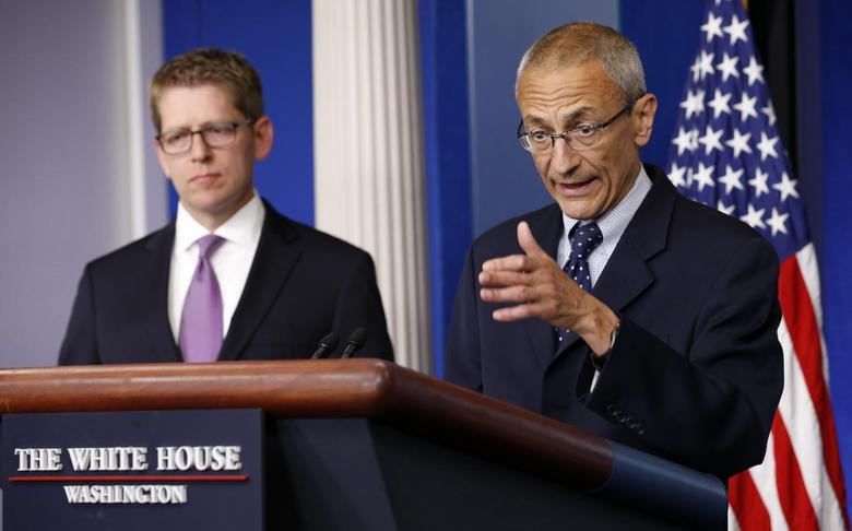 White House senior counselor John Podesta (R) speaks to reporters in the White House briefing room in Washington May 5, 2014. REUTERS/Kevin Lamarque