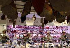 Employees work at the butchery work bench during the opening day of upmarket Italian food hall chain Eataly's flagship store in downtown Milan, March 18, 2014. REUTERS/Alessandro Garofalo