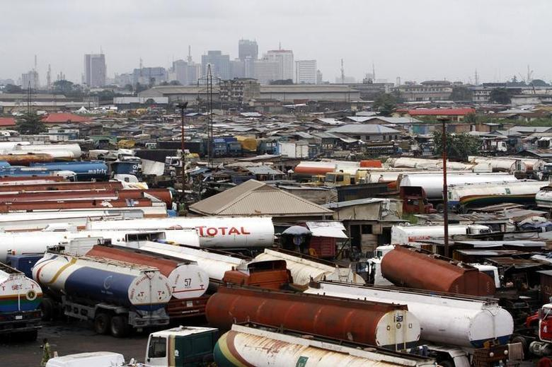 Trucks are seen parked around an automobile workshop overlooking the Lagos business district at the Orile-Iganmu in Lagos August 29, 2013. REUTERS/Akintunde Akinleye