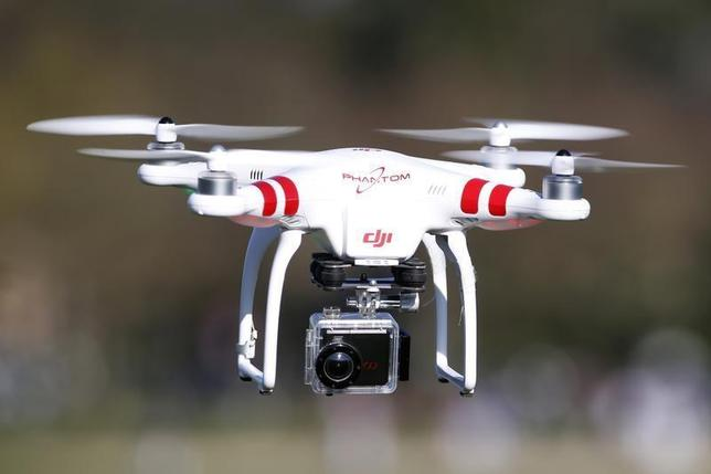 A Phantom drone by DJI company, equipped with a camera, flies during the 4th Intergalactic Meeting of Phantom's Pilots (MIPP) in an open secure area in the Bois de Boulogne, western Paris, March 16, 2014. REUTERS/Charles Platiau