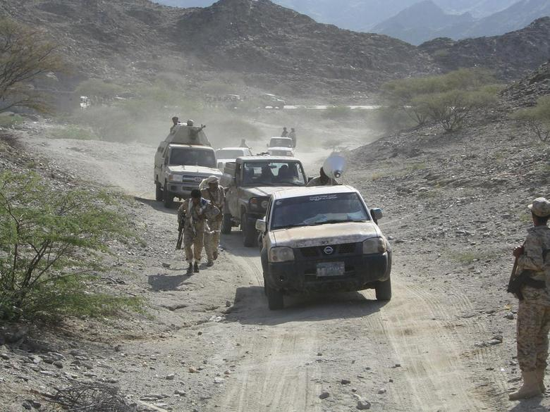 Military vehicles drive on a mountainous road on the frontline of fighting against al Qaeda militants in the southern Yemeni province of Shabwa May 5, 2014, in this photo provided by Yemen's defence ministry. REUTERS/Yemen's Defence Ministry/Handout via Reuters