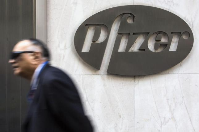 A man walks past Pfizer's world headquarters in New York April 28, 2014. REUTERS/Andrew Kelly