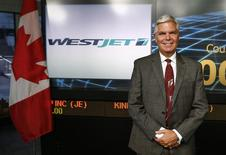 WestJet CEO Gregg Saretsky poses for a picture before the annual general meeting for shareholders at a TMX market opening ceremony in Toronto, May 6, 2014. REUTERS/Mark Blinch