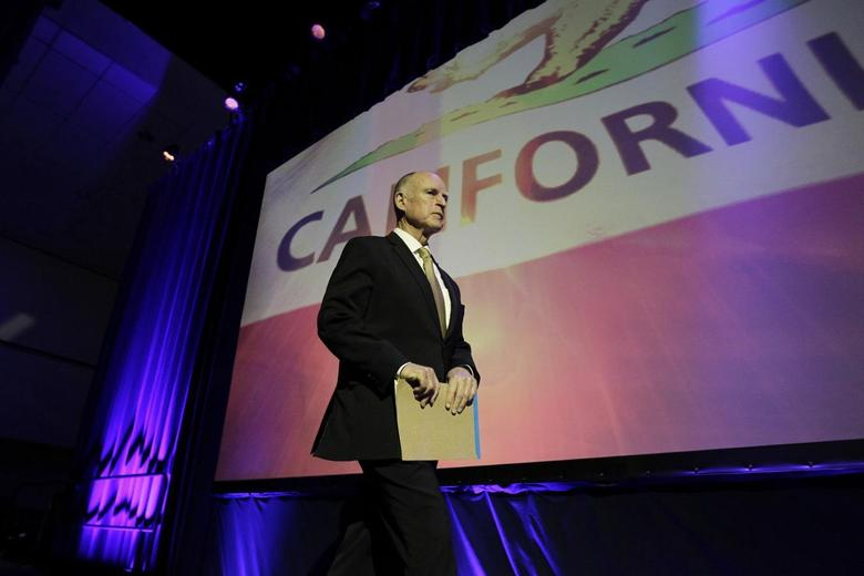 California Governor Jerry Brown walks onstage to speak at the 2014 California Democrats State Convention at the Los Angeles Convention Center in Los Angeles, California, March 8, 2014. REUTERS/David McNew