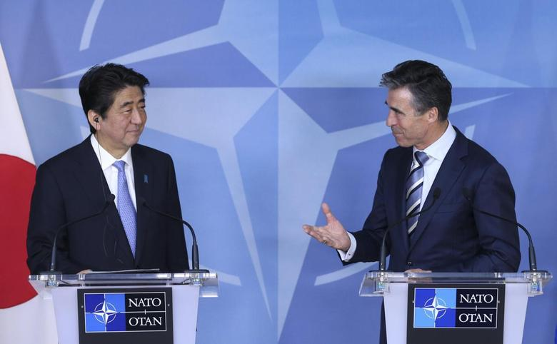 NATO Secretary General Anders Fogh Rasmussen and Japanese Prime Minister Shinzo Abe (L) address a joint news conference at the Alliance headquarters in Brussels May 6, 2014. REUTERS/Francois Lenoir