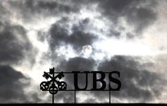 Dark clouds are seen over Swiss bank UBS logo on the company's buiding at Paradeplatz in Zurich, March 3, 2012. REUTERS/Christian Hartmann
