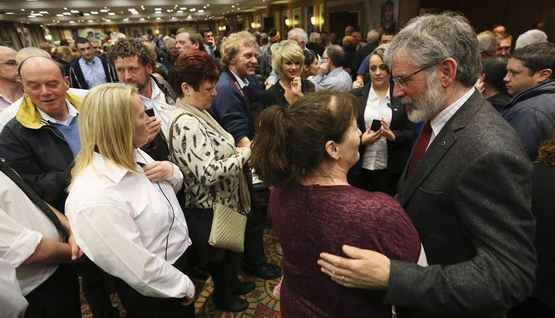 Sinn Fein president Gerry Adams talks with supporters at an election rally in Dublin May 6, 2014. REUTERS/Paul Hackett