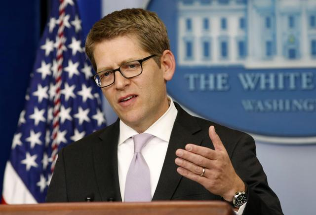 White House press secretary Jay Carney answers questions about health insurance during a briefing at the White House in Washington November 15, 2013. REUTERS/Kevin Lamarque
