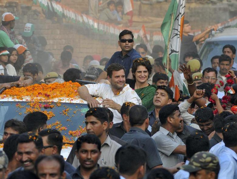 Rahul Gandhi (in white), India's ruling Congress party vice president, and his sister Priyanka Gandhi Vadra attend an election campaign rally in Amethi, in the northern Indian state of Uttar Pradesh May 4, 2014. REUTERS/Stringer