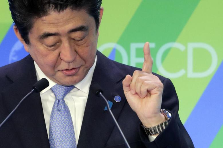 Japanese Prime Minister Shinzo Abe delivers a speech at the Ministerial Meeting of the Organisation for Economic Co-operation and Development (OECD) in Paris, May 6, 2014. REUTERS/Philippe Wojazer