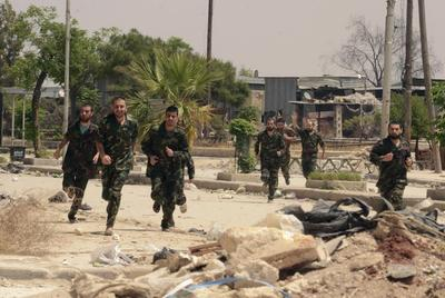 Rebels evacuated from Homs, cradle of Syrian uprising