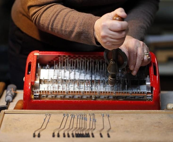 An employee works on an accordion at the Maugein factory in Tulle, in the Correze region central France, March 22, 2014.  REUTERS/Regis Duvignau