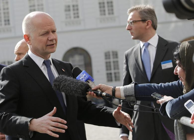 Britain's Foreign Secretary William Hague talks to journalists upon his arrival for a Council of Europe meeting in Vienna May 6, 2014. REUTERS/Leonhard Foeger