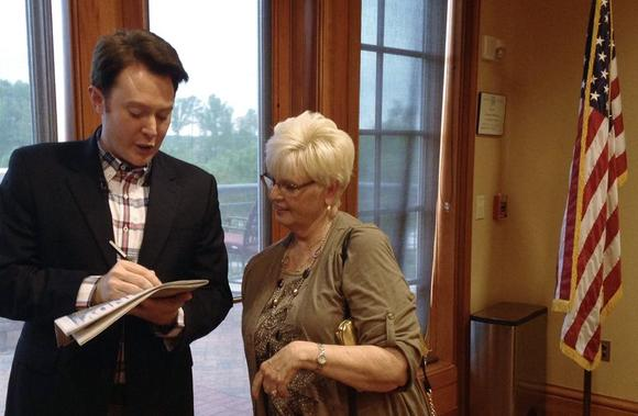 Democratic nominee Clay Aiken signs an autograph for a constituent after a campaign forum in Cary, North Carolina, April 28, 2014. REUTERS/Colleen Jenkins/Files