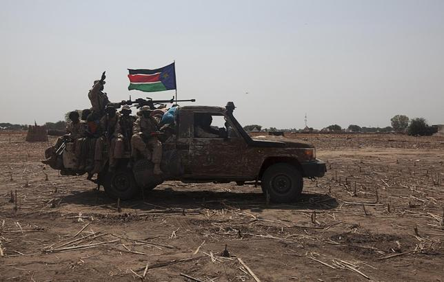SPLA soldiers drive to the frontline at Mathiang from their military base in Bor, South Sudan, January 26, 2014. REUTERS/George Philipas