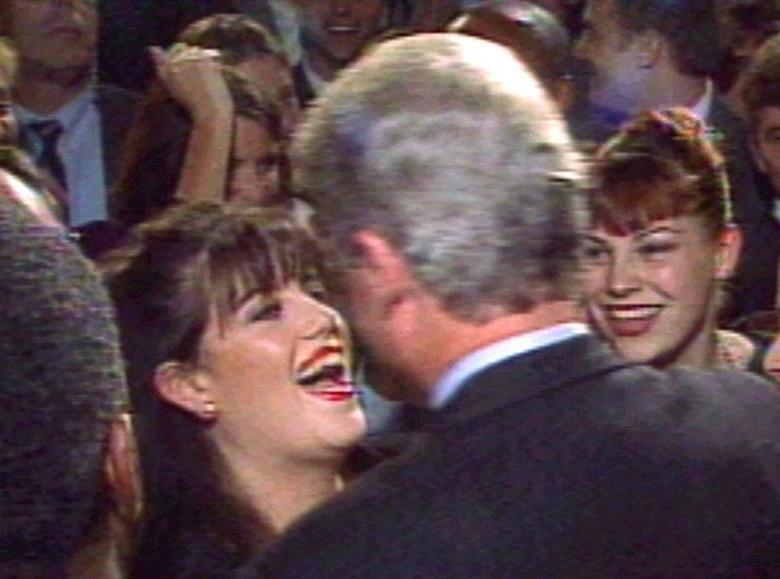 President Clinton greets Monica Lewinsky (L) at a Washington fundraising event in October 1996. REUTERS/File