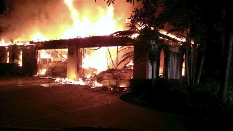Flames engulf a house owned by former tennis pro James Blake in this handout photograph provided by the Hillsborough Sheriff's Office in Tampa, Florida May 7, 2014. REUTERS/Hillsborough County Sheriff's Office/Handout via Reuters