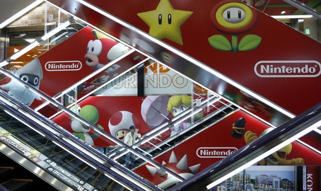 A man rides an escalator past Nintendo Co advertisements at an electronics retail store in Tokyo May 7, 2014. REUTERS/Toru Hanai