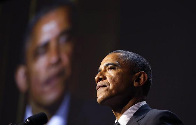 U.S. President Barack Obama speaks after being presented with the Ambassador for Humanity Award by movie producer Steven Spielberg at the USC Shoah Foundation 20th Anniversary Gala in Los Angeles May 7, 2014. REUTERS/Kevin Lamarque