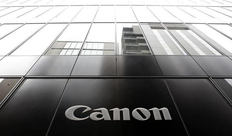 A logo of Canon Inc is pictured at the company's showroom in Tokyo October 24, 2013. REUTERS/Yuya Shino