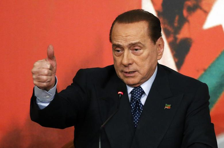 Former Italian Prime Minister Silvio Berlusconi gestures during a meeting in Rome May 7, 2014. REUTERS/Remo Casilli