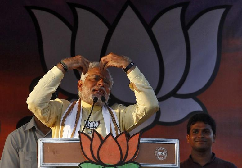Hindu nationalist Narendra Modi (L front), the prime ministerial candidate for India's main opposition Bharatiya Janata Party (BJP), gestures as he addresses an election campaign rally in Barasat, north of Kolkata May 7, 2014. REUTERS/Rupak De Chowdhuri