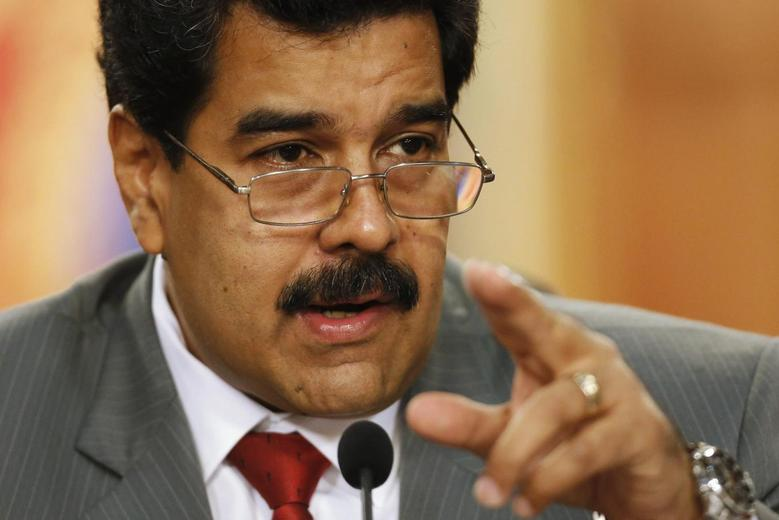Venezuela's President Nicolas Maduro speaks during a news conference at Miraflores Palace in Caracas, in this March 14, 2014 file picture. REUTERS/Carlos Garcia Rawlins/Files