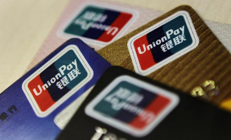 Logos of China UnionPay are seen on bank cards in this photo illustration taken in Beijing December 5, 2013. REUTERS/Barry Huang