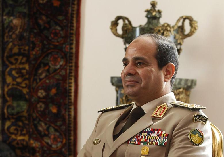Egypt's Army Chief General Abdel Fattah al-Sisi attends a meeting with Egypt's interim President Adly Mansour, Russia's Defence Minister Sergei Shoigu and Foreign Minister Sergei Lavrov (not pictured) at El-Thadiya presidential palace in Cairo, November 14, 2013. REUTERS/Amr Abdallah Dalsh