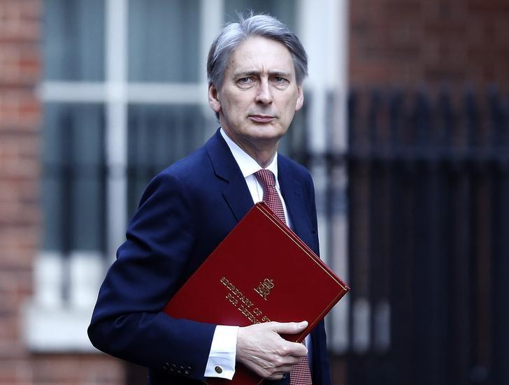Britain's Defence Secretary Philip Hammond arrives to attend a Cabinet meeting at Number 10 Downing Street in London March 4, 2014. REUTERS/Olivia Harris