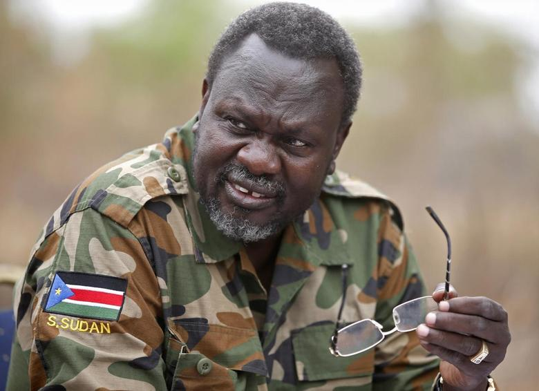 South Sudan's rebel leader Riek Machar speaks to rebel General Peter Gatdet Yaka (not seen) in a rebel controlled territory in Jonglei State February 1, 2014. REUTERS/Goran Tomasevic
