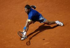 Rafael Nadal of Spain returns the ball to Jarkko Nieminen of Finland during their match at the Madrid Open tennis tournament May 8, 2014. REUTERS/Susana Vera