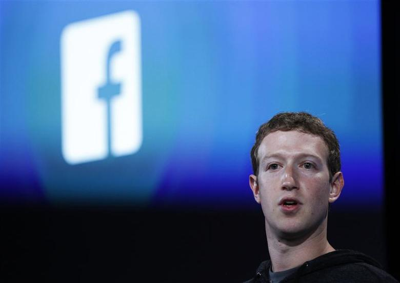Mark Zuckerberg, Facebook's co-founder and chief executive introduces 'Home' a Facebook app suite that integrates with Android, during a news conference in Menlo Park, California in this file photo taken April 4, 2013. REUTERS/Robert Galbraith/Files