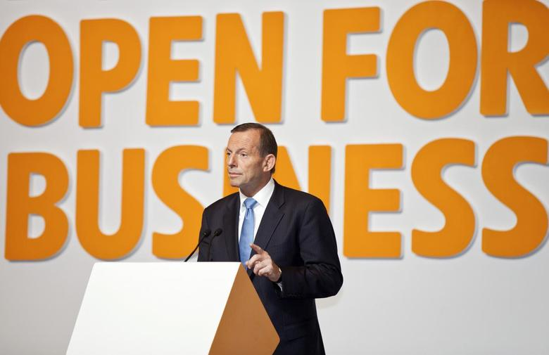 Australian Prime Minister Tony Abbott gestures as he gives a speech on a business event at the Shanghai International Expo Centre in Shanghai, April 11, 2014. REUTERS/Stringer