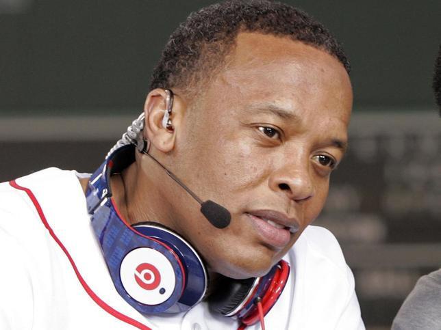 Recording artist Dr. Dre wears a pair of Beats headphones as he attends the MLB 2010 season opener between the New York Yankees and Boston Red Sox at Fenway Park in Boston, in this file photo taken April 4, 2010. REUTERS/Adam Hunger/Files