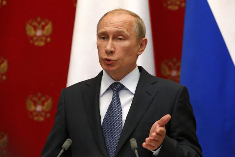 Russian President Vladimir Putin speaks during a news conference after a meeting with Swiss President and Foreign Minister Didier Burkhalter at the Kremlin in Moscow, May 7, 2014. REUTERS/Sergei Karpukhin