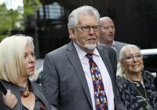 Entertainer Rolf Harris arrives at Southwark Crown Court, with his daughter Bindi (L) and wife Alwen Hughes,  in London May 9, 2014.  REUTERS/ Olivia Harris