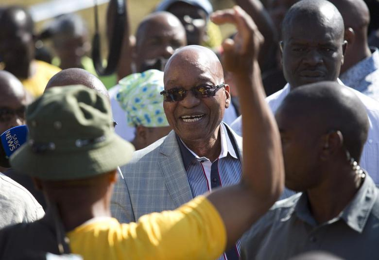 South African President Jacob Zuma greets supporters of African National Congress after voting at a voting station in the Nkandla district May 7, 2014. REUTERS/Rogan Ward