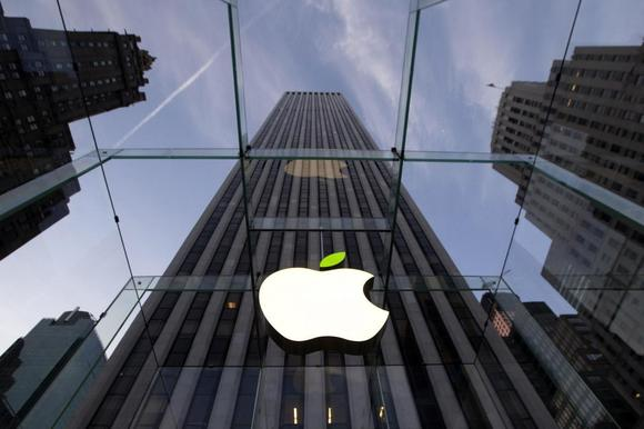 The leaf on the Apple symbol is tinted green at the Apple flagship store on 5th Ave in New York April 22, 2014. Employees and signage have been themed green to mark Earth Day. REUTERS/Brendan McDermid