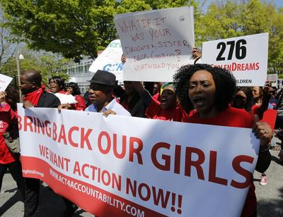 Nigerian president says believes kidnapped girls still...
