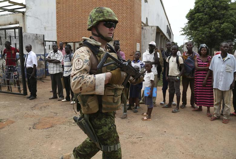 An Estonian soldier from the newly deployed EUFOR-RCA European Union military operation in the Central African Republic, carries his weapon while going on patrol in Bangui May 8, 2014. REUTERS/Emmanuel Braun