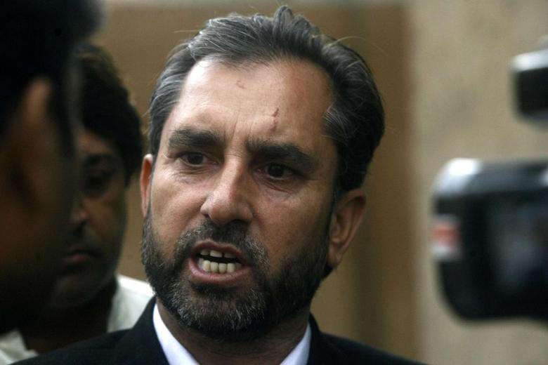 Samiullah Afridi, lawyer for Shakil Afridi who ran a fake vaccination campaign to try help U.S. officials find al-Qaeda chief Osama bin laden, speaks to the media after appearing before the court in Peshawar October 30, 2013. REUTERS/Khuram Parvez