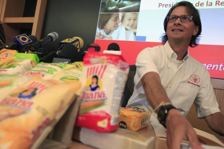 Lorenzo Mendoza, owner of Venezuela's largest private food production company Empresas Polar, attends a news conference in Caracas May 13, 2013. REUTERS/Jorge Silva